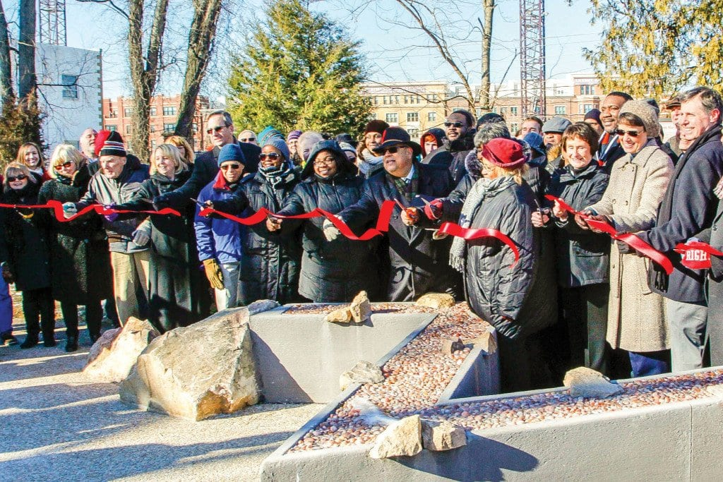IT WAS A LONG RIBBON at the historic Tinner Hill Heritage Foundation site Saturday to accommodate a portion of the many dignitaries who braved 17 degree weather to be there, from Falls Church Planning Commissioner Lindy Hockenberry (farthest left) to F.C. Mayor David Tarter (farthest right). Among those others identifiable under their bundlings, Fairfax County Board Chair Sharon Bulova, Roger Neighborgall, F.C. Assistant City Manager Cindy Mester and Edwin B. Henderson II. (Photo: Gary mester)
