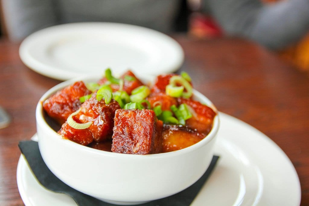 Mad Fox's pork belly bites are dressed up in a black saison BBQ sauce. (Photo: News-Press)