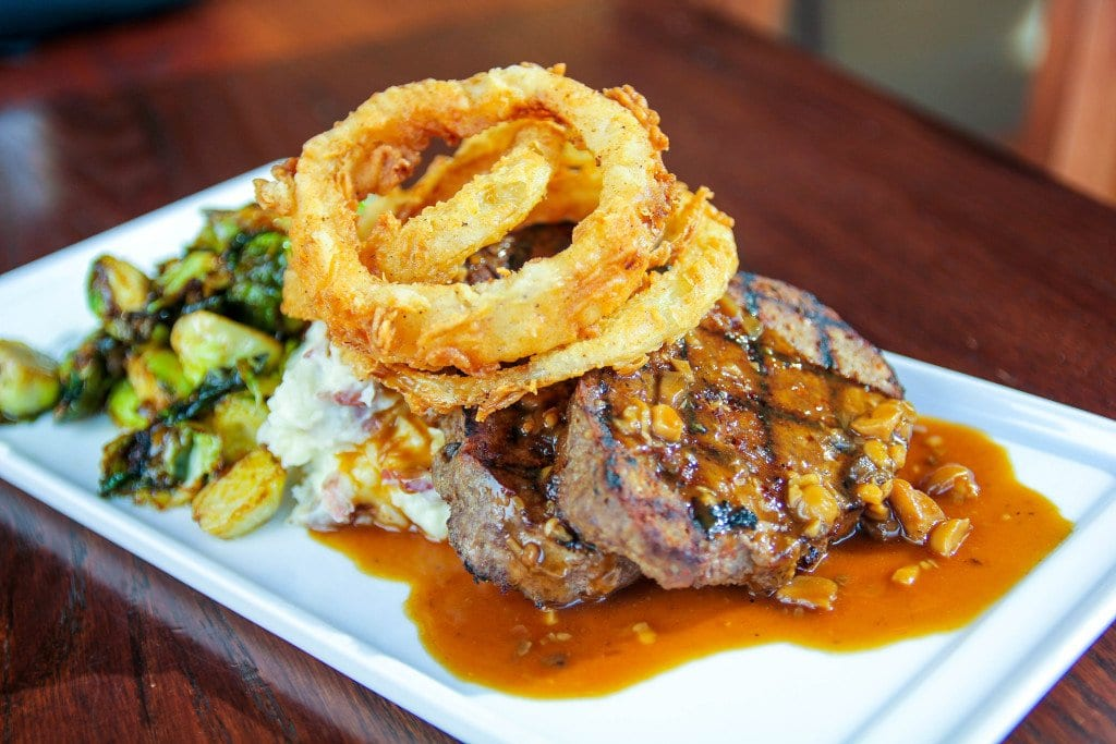 Kerry's meatloaf, served with skin-on redskin mashed potatoes, maple-bacon flash-fried Brussels sprouts, tobacco onions and brandy mushroom gravy, is one of Mad Fox's most popular dinner dishes that's also available... (Photo: News-Press)
