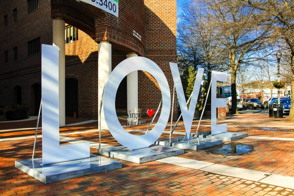 """ONE OF VIRGINIA TOURISM CORPORATION'S 'LOVE' sculptures, part of its promotional """"Love Works"""" program built on the """"Virginia Is for Lovers"""" slogan, has been loaned to the organizers of Watch Night, the 17th annual New Year's Eve celebration in downtown City of Falls Church. The new initiative begun in 2014 is called """"Bring LOVE to Your Town."""" """"Our iconic Virginia is for Lovers brand is about love – pure and simple – and has been for more than 40 years,"""" said Alisa Bailey, president and CEO of the Virginia Tourism Corporation. (Photo: News-Press)"""