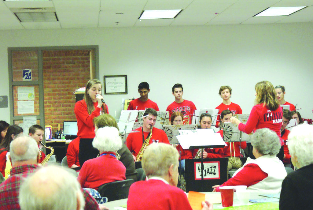 George Mason senior Beth Cashin sings with the jazz band for the senior citizens at the Falls Church Community Center. The performance was one of two shows for the George Mason Jazz Band last Tuesday. (Photo: Carol Sly)