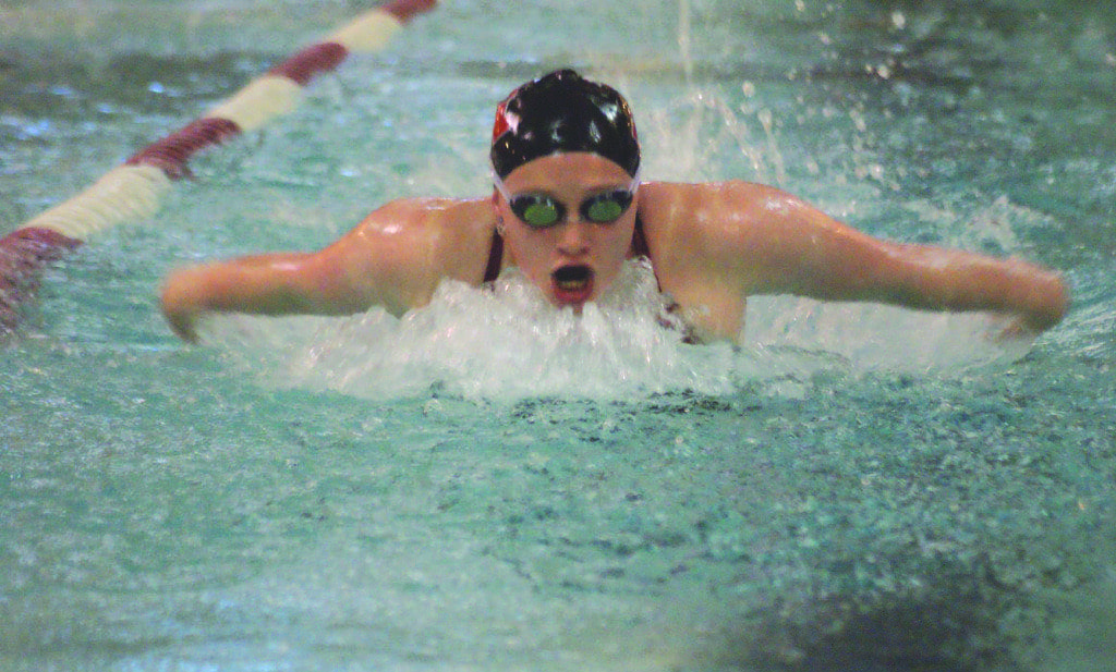 Mustang junior francesca king swims in the 100-yard butterfly event during Mason's dominant victories in the tri-meet last Saturday against Central and Manassas Park. King qualified for the state meet in that event and the 200-yard individual medley. (Photo: Carol Sly)