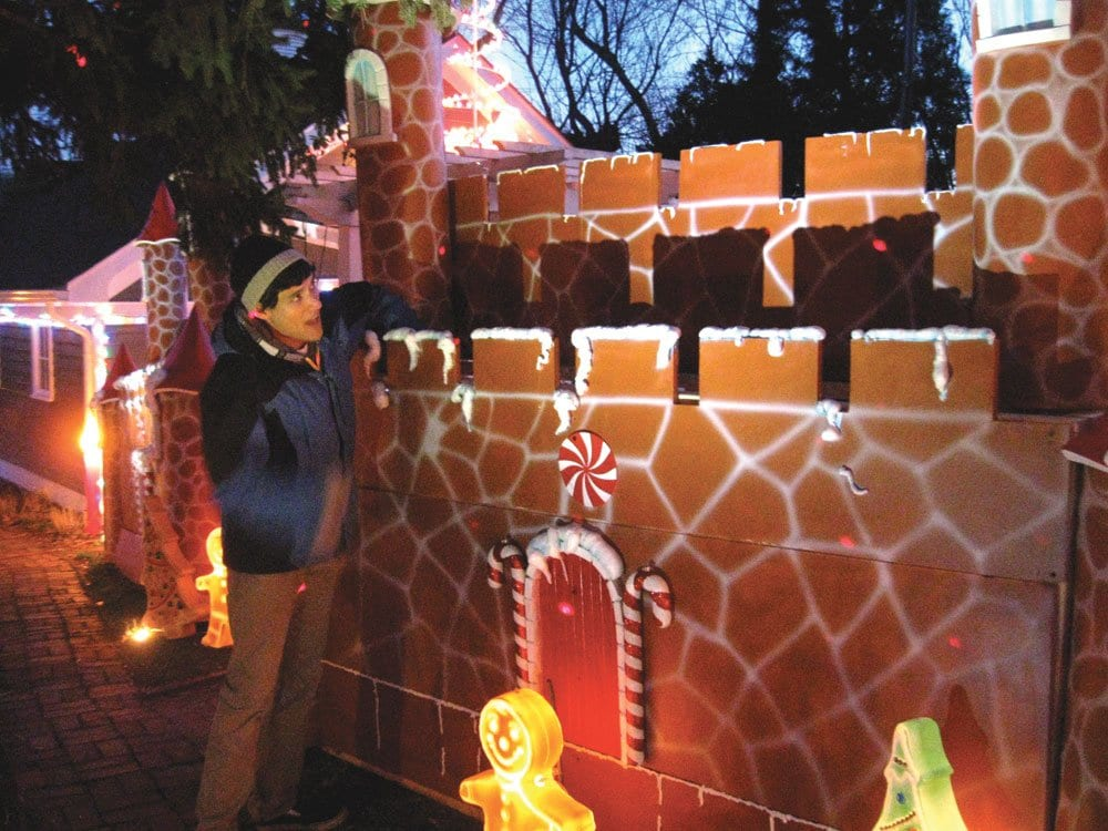 JACK LANOUETTE PUTS SOME finishing touches on the decorations at his home's Christmas display on East Broad Street. (Photo: News-Press)
