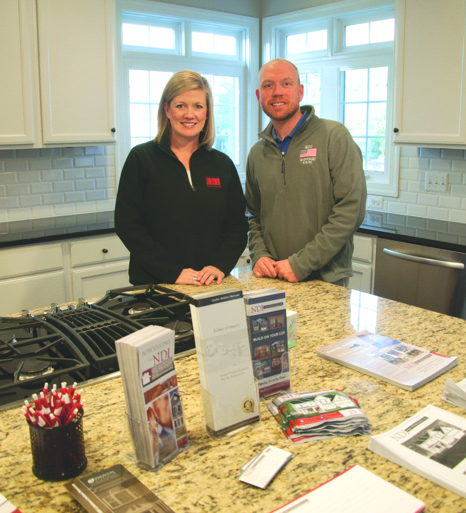 jennifer landers (left), president of New Dimensions, Inc., stands with her brother Adam Alderson, director of construction operations for New Dimensions, in one of the company's model homes. (Photo: News-Press)