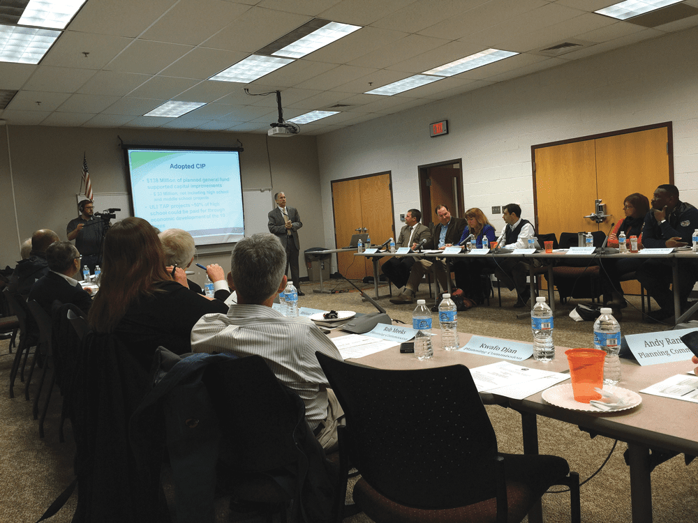 FALLS CHURCH CITY MANAGER Wyatt Shields presents the state of the City as over three dozen community leaders look on Monday night. (Photo: News-Press)