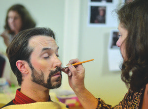 """Nick DePinto, who played Lucius Heron – a parody of character Seneca Crane – in """"The Black Friday Games,"""" gets make up. (Photo: Courtesy of Bard Tales Productions and Ciscovaras Pictures)"""