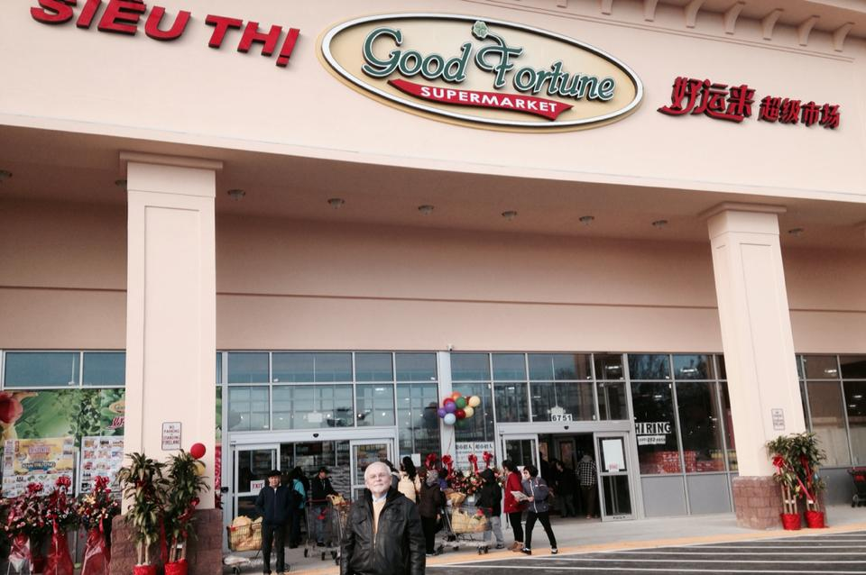 Councilman Phil Duncan poses in front of the Good Fortune supermarket which opened in the Eden Center Saturday.