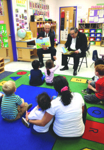 Retired Brigadier General Lawrence Gillespie and retired Rear Admiral Kenneth Moritsugu read books with the children at the Falls Church-McLean Children's Center on Monday. (Photo: Courtesy of David Carrier)