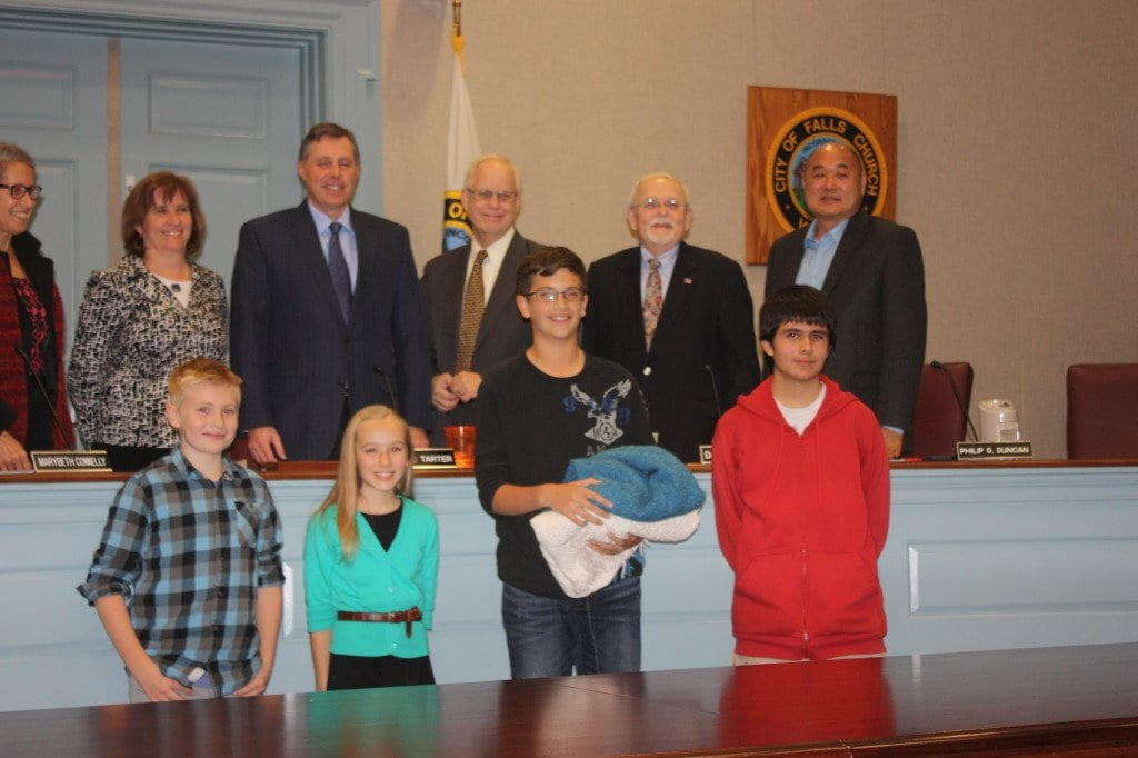 Student organizers of a blanket collection drive in Falls Church reported on their progress at tonight's Falls Church City Council meeting. The blankets are being collected to assist refugees the conflicts in Syria and Iraq. Left to right: Matthew Shaffer, Ciara Curtin, Benjamni Smoke, Orion Date. (Photo: News-Press)
