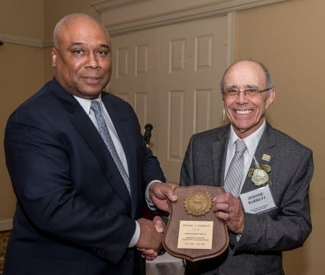 Northern Virginia community College's board of trustees chairman Dr. Michael Wooten presents the Distinguised Service Award to Dr. Jerome Barrett. (Photo: Courtesy of Northern Virginia Community College)