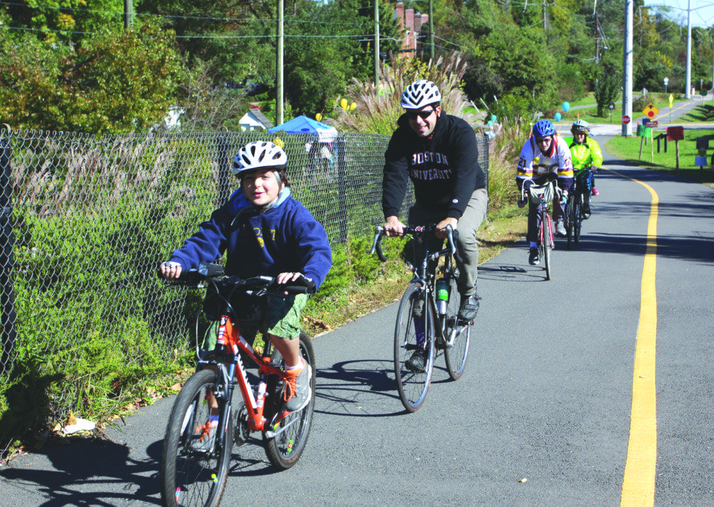 Bikers roll along the W & OD Trail during the Friends of the Falls Church Shelter's third annual ShelterRide on Sunday, Oct. 19. The Friends of the Falls Church Homeless Shelter said that they raised nearly $1,500 from the event, which will go to the Falls Church Homeless Shelter. Sponsors of the event included Bikenetics, Mike's Deli at Lazy Sundae, Nourish Market and Blue Nectar Yoga. (Courtesy Photo)
