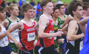 Seniors Jonathan (left) and Timothy Gilmour run with the pack at the Glory Days Meet last Saturday. They were the third and fourth runners to finish for Mason, respectively. (Photo: Carol Sly)