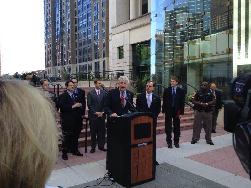Virginia Attorney General Mark Herring (center) and Arlington County officials, including Arlington County Board Chair Jay Fisette, Clerk of the Court Paul Ferguson and others, gathered at the Arlington County Courthouse Monday, where Herring announced that same-sex marriage was now legal in the Commonwealth. (Photo: Mary Curtius)