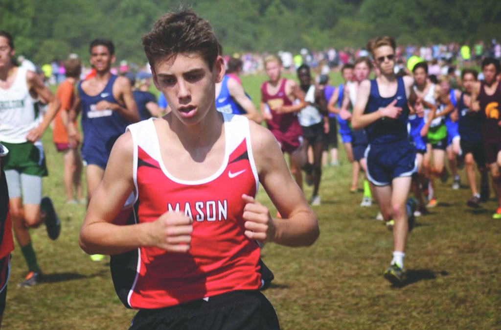 Mason Freshman Danny Mineo ran strong in the underclassmen boys race at the Oatlands Invitational, placing 167th out of 532 runners. Although neither the boys or girls team had top three finishes at the race, both teams achieved team bests at the invitational. (Photo: Carol Sly)