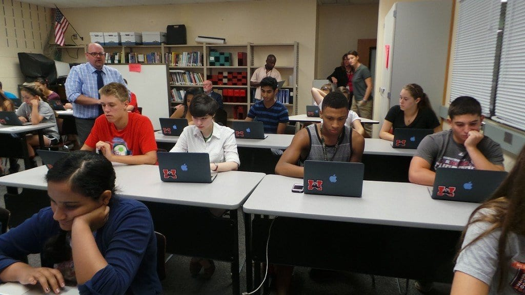 GEORGE MASON HIGH SCHOOL students sit in an orientation session after checking out their newly issued laptops. The sessions were led by Mason Technology Coordinator Steven Knight who taught parents and students how to use the laptops. (Photo: Falls Church City Public Schools)