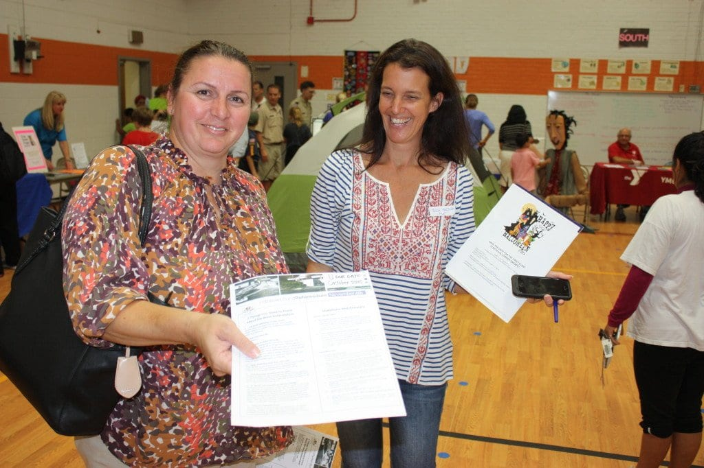 GABI SANDOZ (left) president of the Mason High PTSA and Trish Horowitz, president of the Elementary PTA, compared notes Tuesday at the annual Thomas Jefferson Ice Cream Social and Information Fair. A record attendance at the school year kick-off event provided plenty of opportunities for case to be made for passing the November referendum. (Photo: News-Press)