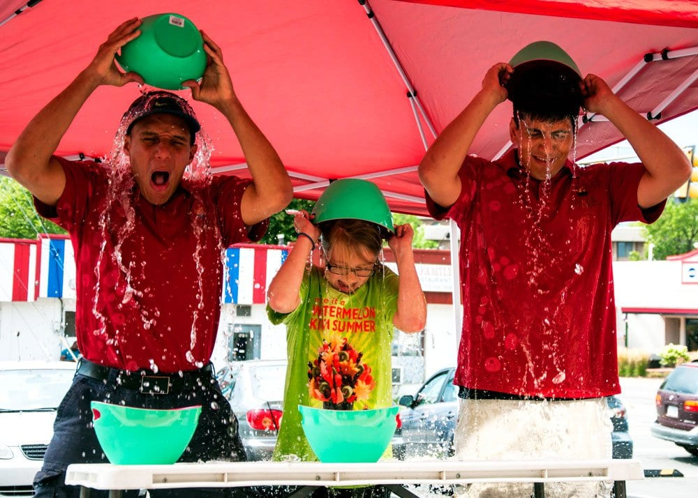 ACCEPTING THE ALS ICE BUCKET CHALLENGE, Oscar Soto, Taylor Smith and George Weiss (left to right) of Falls Church's Edible Arrangements, dumped buckets of water on their heads at the Annandale Road store last Wednesday, August 20. In addition to completeing the challenge, the store donated $100 to an ALS organization. (Photo: News-Press)