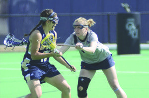 Abby Johansen (right) defends a player during one of the Old Dominion University Lady Monarch's lacrosse games this past season. Johansen, a 2011 graduate of George Mason High School, was named to the Intercollegiate Women's Lacrosse Coaches Association's Academic Honor Roll last week. (Courtesy Photo)