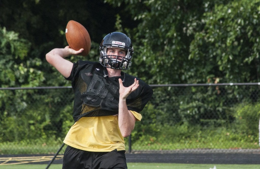 Senior quarterback and safety Sam Selby looks for an open receiver during the Mustangs 11-on-11 drills. (Photo: News-Press)