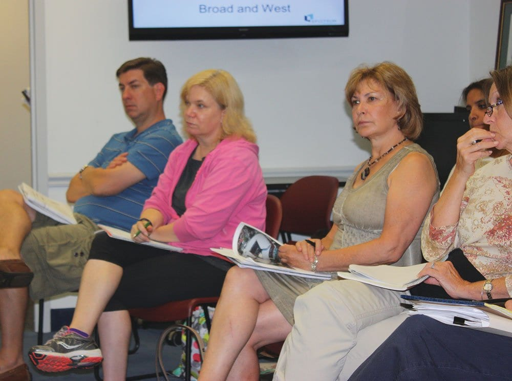 SALLY COLE (center), executive director of the Falls Church Chamber of Commerce, was present for the presentation on the Broad and N. West Street project Monday. Pending a go-ahead for more extensive community discussion expected to come this Monday, the Chamber will weigh in with its recommendations. (Photo: News-Press)