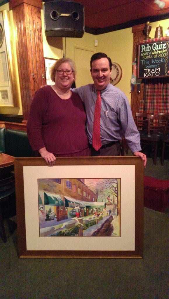 Former City of Falls Church treasurer Cathy Kaye (left) is seen above with Colm Dillon, owner of Ireland's Four Provinces restaurant, and the painting she donated to the 4P's last week.