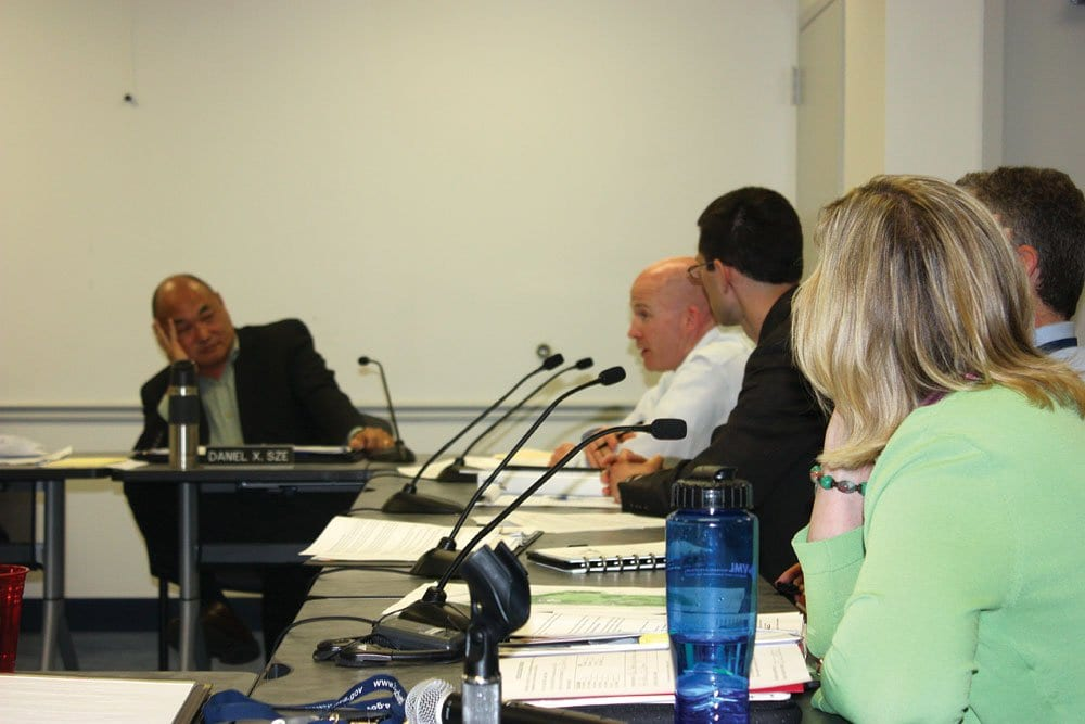 SUBJECT OF AN INTENSE discussion at Monday's Falls Church City Council work session, Councilman Dan Sze (left) confronts the City staff on plans to delay traffic calming work at the intersection of Parker and Kent.
