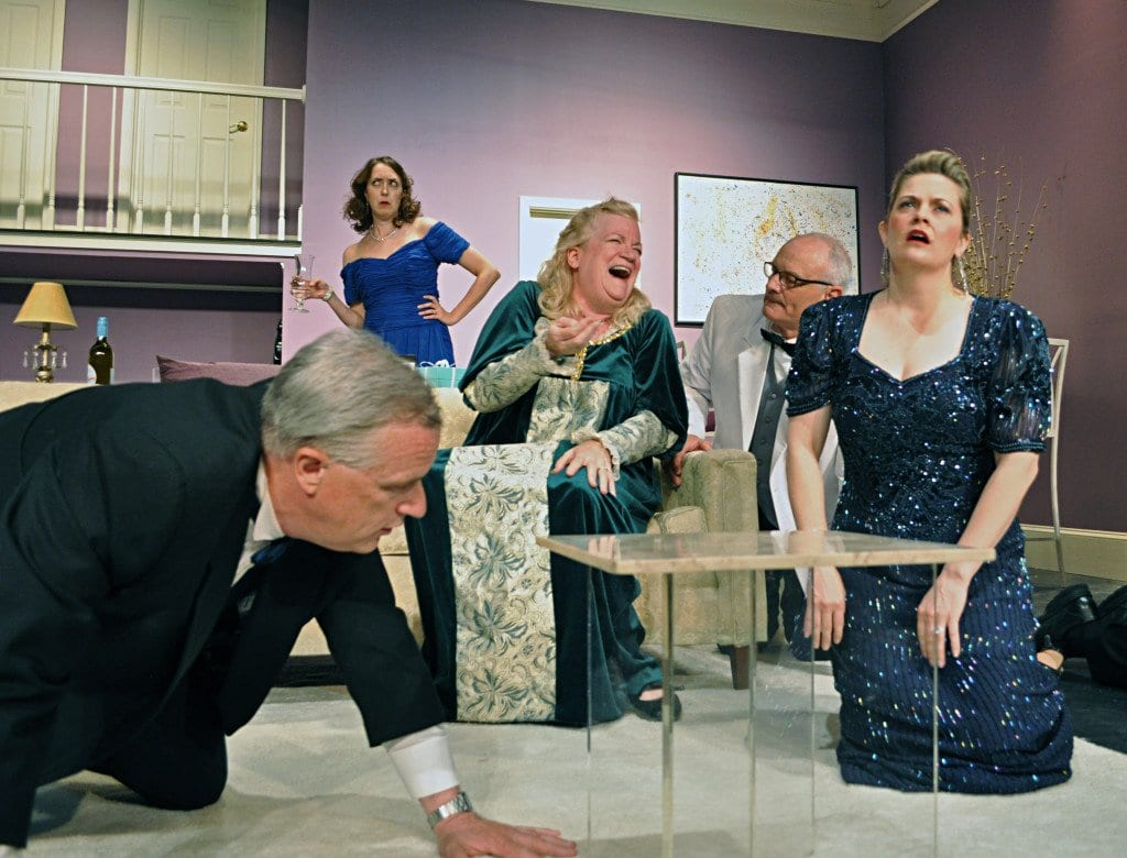 """The comedy flows as mishaps multiply and rumors abound in the Providence Players production of Neil Simon's """"Rumors."""" Pictured above, from left to right, are actors Don Myers, Andra Whitt (standing), Beth Hughes-Brown, Craig Geoffrion, and Charlene Sloan. (Photo: Chip Gertzog, Providence Players)"""