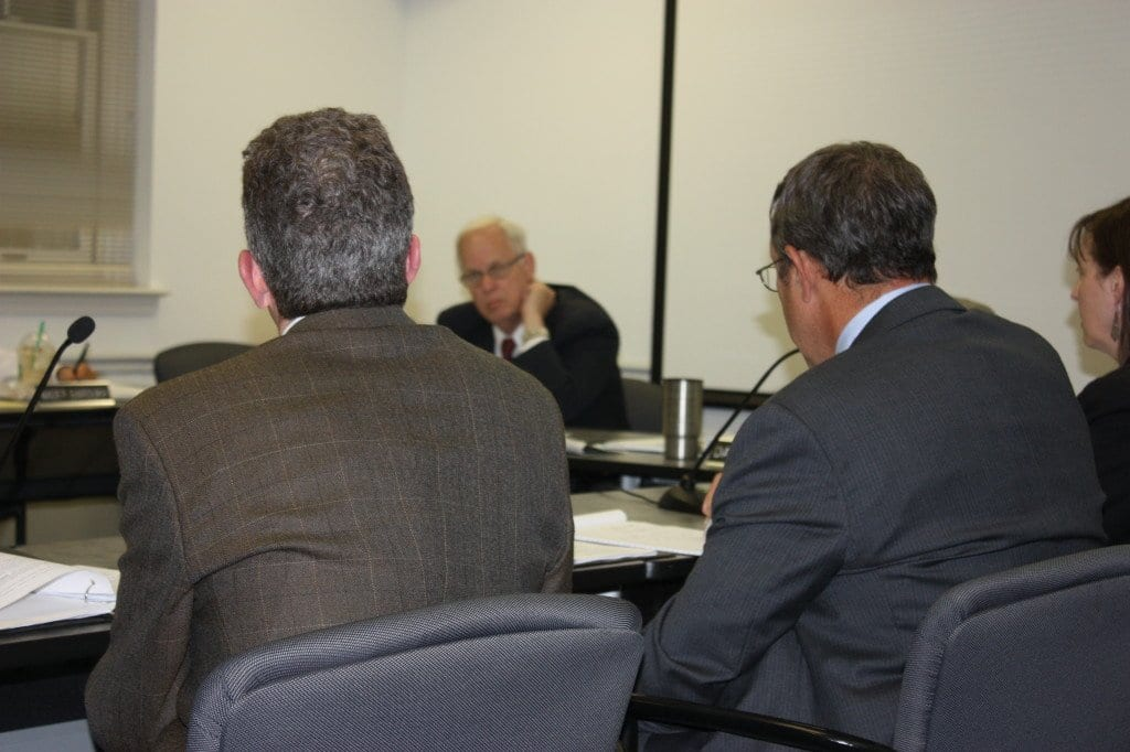 FALLS CHURCH VICE MAYOR DAVID SNYDER (background) grills City Manager Wyatt Shields (foreground) on when he knew the cash proceeds from the sale of the water system would exceed $20 million). (Photo: News-Press)