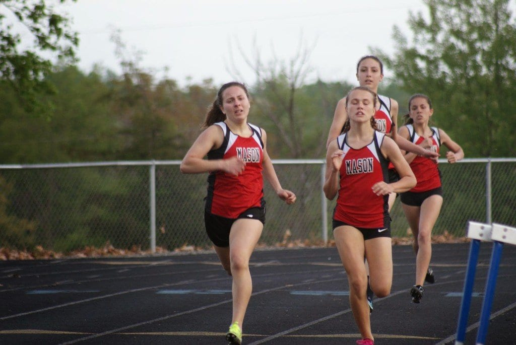 The Mason High boys and girls track teams both swept the top five places in the 800-meter run at a three-way meet at Madison County High School with Rappahannock County High School last Wednesday. Pictured above are, from left to right, Sarah Macris, Elizabeth Ward, Coral Gillette, and Anna Sawyer, who took second through fifth place in the girls race after first-place runner Blaise Sevier. (Photo: Courtesy Carol Sly)