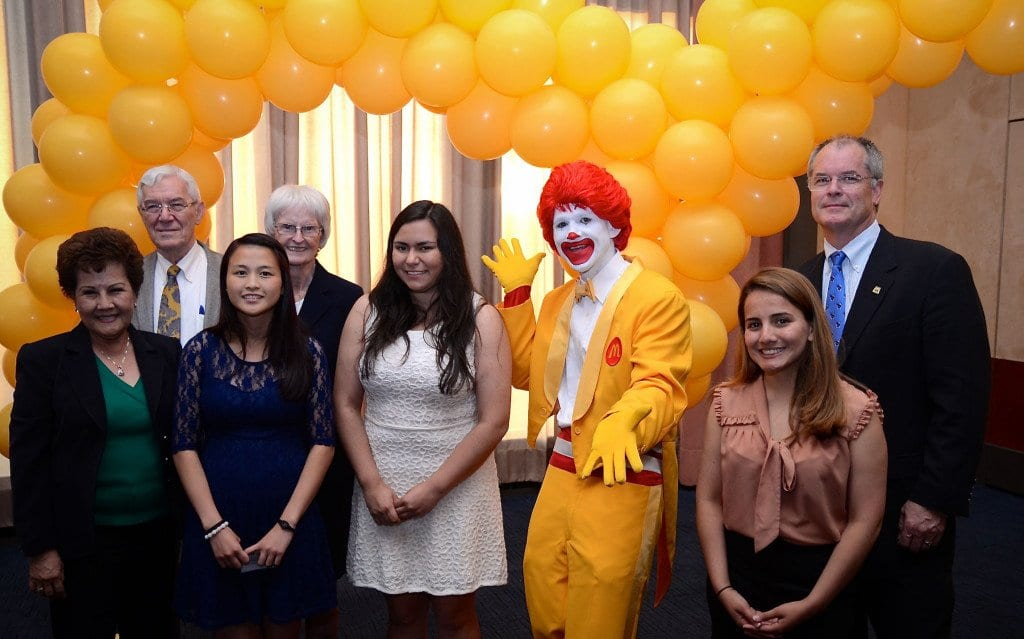 Three of five scholarship winners from Falls Church are pictured above with three local McDonald's owners and Ronald McDonald. (Photo: Gee James)