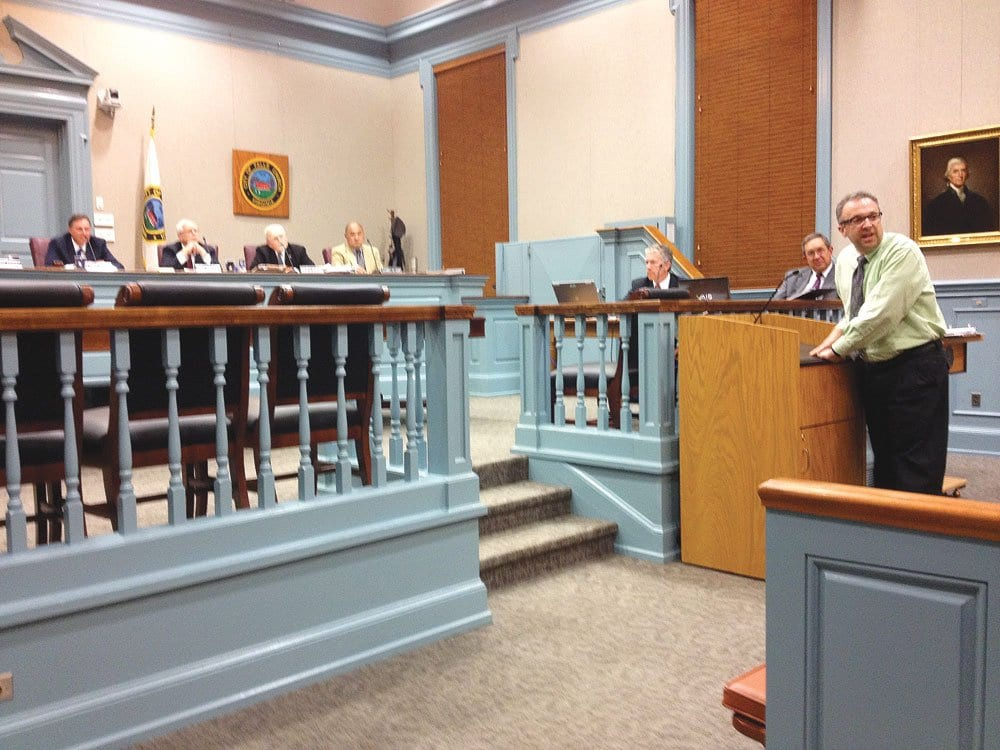 F.C. Education Association vice chair Joel Block (at podium) calls for supporters of the school budget to rise during Monday's F.C. Council meeting. (Photo: News-Press)