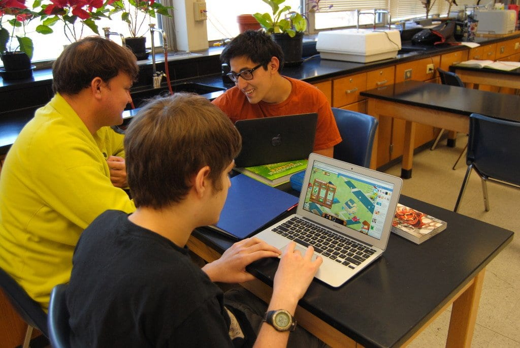 At a launch event for the video game Stormwater Sentries, released in April on Facebook, teacher Jamie Lahy (far right) and sophomores Max Loftis (center) and Sam Luten (far right) played Stormwater Sentries.