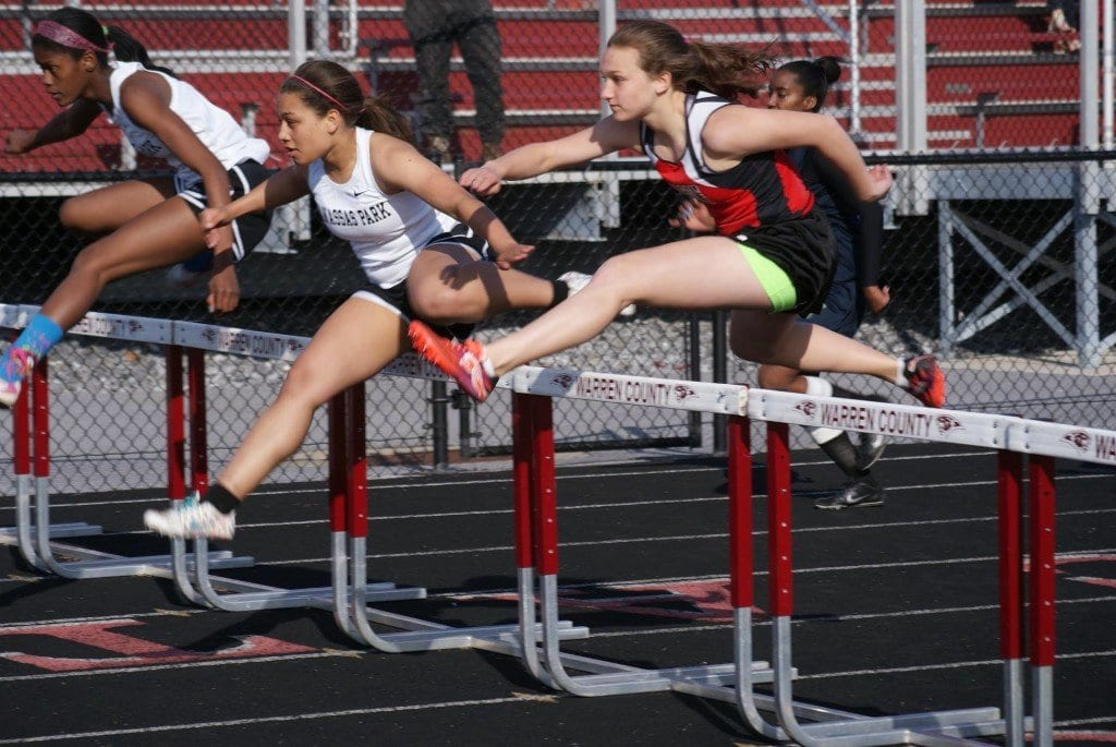 Mason's Korinne Wills went out fast for second in the 100-meter hurdles (18.5). (Photo: Courtesy Carol Sly)