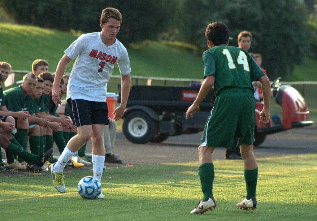 George Mason senior midfielder Paul Darmstadter gets ready to try to dribble around a player from Wilson Memorial High School in May 2013.  Darmstadter has 12 goals and seven assists so far in the 2014 season.  (Photo: Drew Costley)