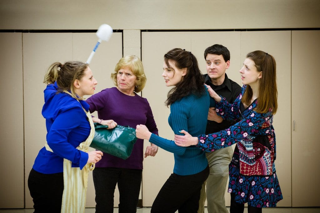 """In a scene from the McLean Community Players' production of """"Perfect Wedding,"""" Julie the chambermaid (Rebecca Fischler) gives her opinion of the goings on to the members of the wedding party (Carole Steele, Jessica Inzeo, Will McLeod, and Caitey Brown). The McLean Players will present the farce by British playwright Robin Hawdon this month and next at the McLean Community Center's Alden Theatre. (Photo: Traci J. Brooks Studios)"""