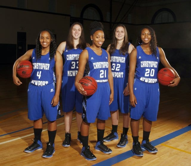 Former George Mason players Chantal Thomas (wearing number 22) and Nicole Mitchell (wearing number 33) are pictured with their Christopher Newport teammates. During their four-year career, the Christopher Newport Captains went 105-19. (Courtesy Photo)