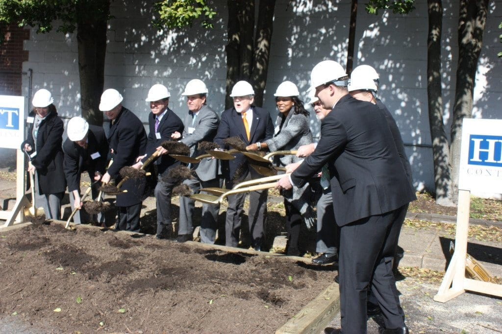 CEREMONIALLY BREAKING GROUND on the $100 million Harris Teeter development project on the old post office parking lot Monday morning were a collection of City officials, including Mayor David Tarter and City Manager Wyatt Shields, the Rushmark development team mugging it in a photo op while cameras snapped Monday morning. The project is expected to be completed in roughly two years. (Photo: News-Press)