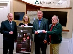 """Falls Church's Harry Shovlin (far right) of Strange Bedfellow presents a check for more than $3,000 to James Zabora (second from right), director of Life With Cancer, a part of INOVA Health Foundation in Northern Virginia. Joining the presentation are Ken Feltman (far left), a co-founder with Shovlin of Strange Bedfellow, and Carol Loftur-Thun (second from left), production manager for """"The Actual Dance,"""" a new and critically acclaimed play that Strange Bedfellow produced as the centerpiece of the fundraising effort. (Courtesy Photo)"""