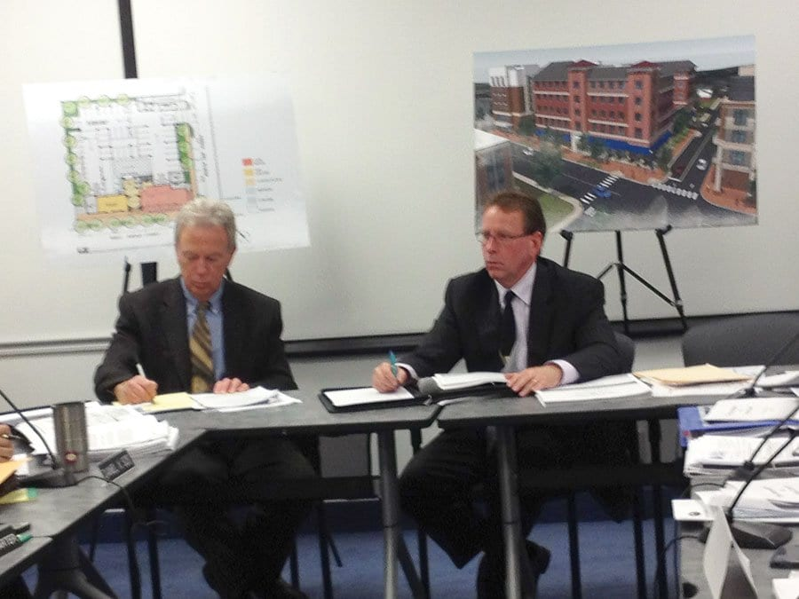 DEVELOPER ED NOVAK (seated right) presented new elements of his plans for the Kensington assisted living facility on the site of the current Burger King on W. Broad St. To his right is Rick Goff of the City's Economic Development Office. (Photo: News-Press)
