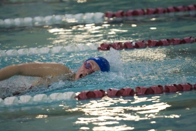 Mason swimmer Erin McFall qualified last Saturday for the state meet with her times in the 100- and 200-yard freestyle. Her time in the latter set a new school record (2:05.96), besting one previously held by teammate Francesca King (Photo: Courtesy Penney Hokaj)