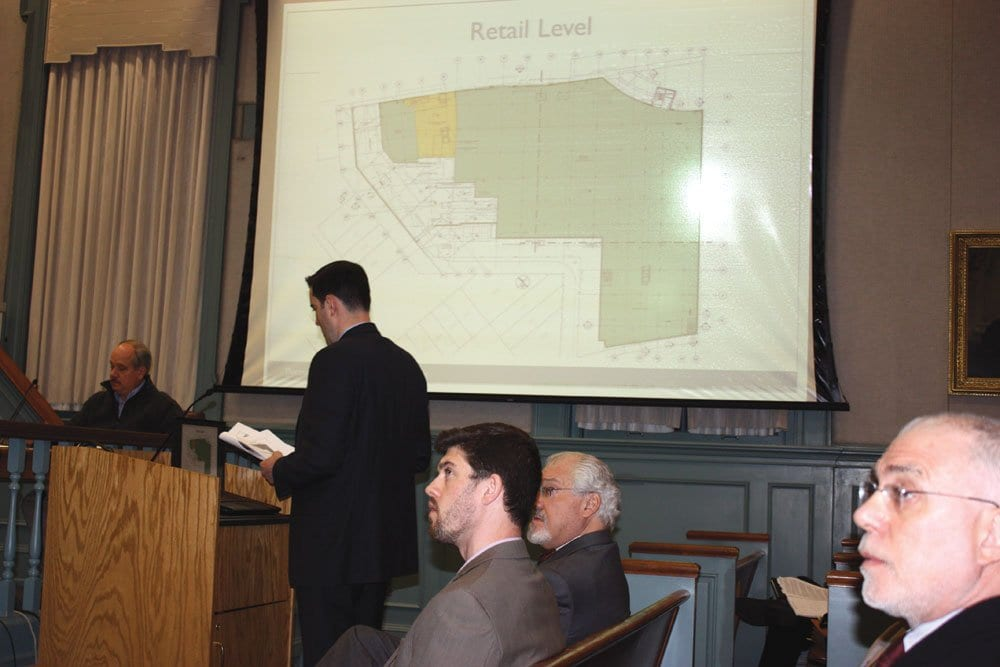 RUSHMARK PROPERTIES' development manager Stefan Gassner, at the podium, refers to a power-point presentation while speaking to the Falls Church Planning Commission Monday night. The Planners gave a unanimous 7-0 final approval to the site plan for the project that will include a Harris Teeter in the 300 block of W. Broad.  (Photo: News-Press)