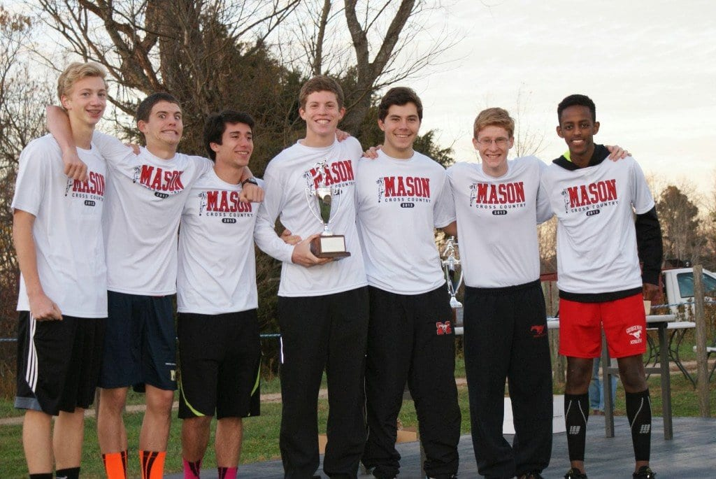 Mason boys cross country runners pictured with their second-place trophy Region 2A-East are, from left to right, Jackson Jost, Preston Custer, John Marshall, Truman  Custer, Austin Gogal, James Pala, and Beamlak Hailemariam. (Photo: Carol Sly)