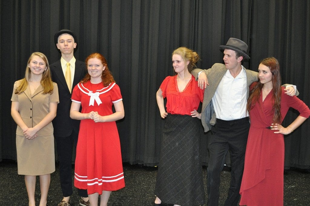 """""""Annie,"""" performed by McLean High School's McLean Theatre Company, features lead characters, pictured from left to right, Grace Farrell (Nicole Sheehan), Daddy Warbucks (Jack Posey), Annie (Nancy Pruett), Mrs. Hannigan (Rachel Lawhead), Rooster (Thomas Kelty), and Lily St. Regis (Abby Huston). (Photo: Karen Perry)"""