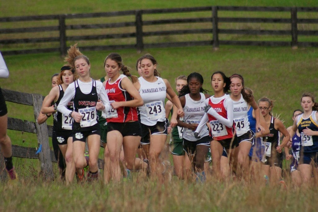 Mason girls runner Kaitlin Kutchma is pictured off the start, followed by Grace Eye.  (Photo: Carol Sly)