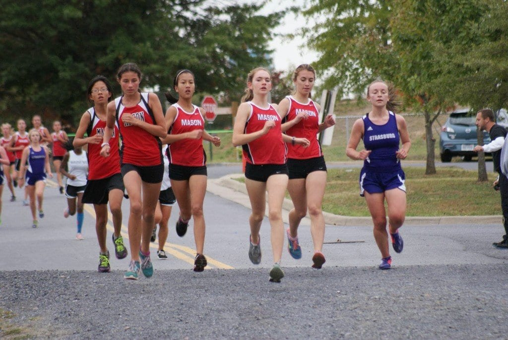 Five Mason girls were dominating the 5K course after first loop at a tri-meet at Strasburg High School last Wednesday. Pictured above, from left to right, are eighth-graders Logan Funk and Estelle Timar-Wilcox; sophomores Grace Eye and Blaise Sevier; and junior Kaitlin Kutchma. (Photo: Courtesy Carol Sly)