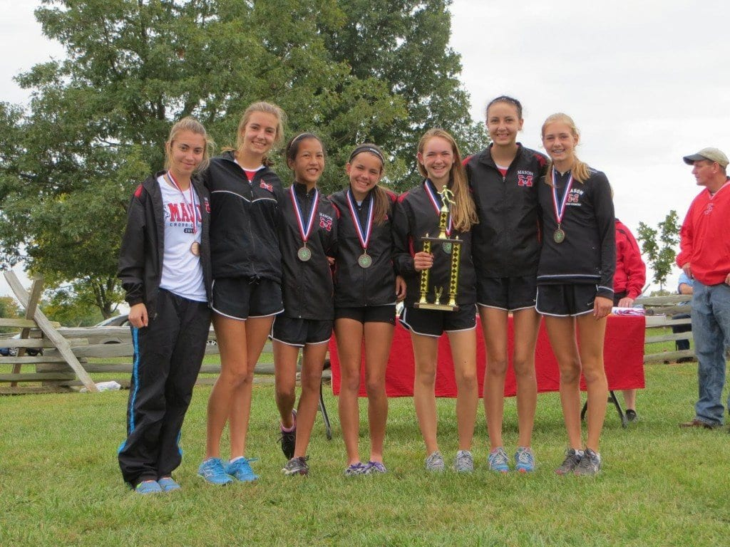 The Mason girls varsity team is pictured above with its trophy for first place. Pictured above, from left to right, are Kaitlin Kutchma, Lauren Meinhart, Grace Eye, Mia Sawyer, Blaise Sevier, Coral Gillette, and Brooke Meinhart. (Photo: Ray Meinhart)