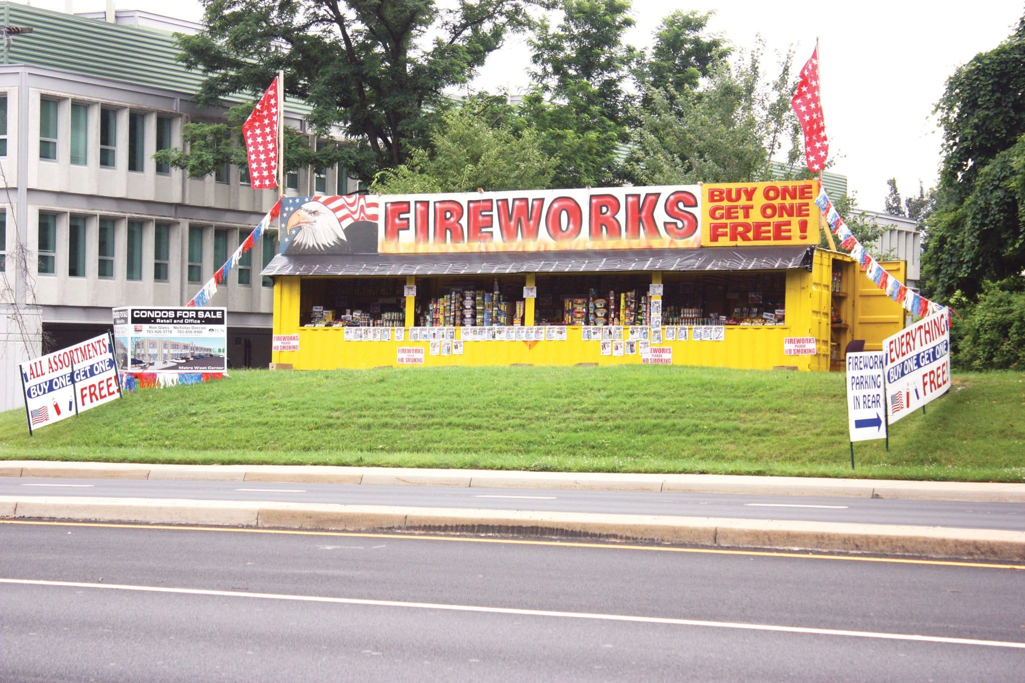 "THIS FAMILIAR FIREWORKS STAND has been set up on Route 7 just outside the city limits of Falls Church for many years. But this year, with F.C. now having its own fire marshal, after years of contracting that service from Arlington County, a stiff notice was sent out from City Hall last week warning that ""possession, manufacture, storage, sale and unauthorized use of fireworks are illegal in the City of Falls Church. This includes all consumer fireworks."" Illegal are firecrackers, torpedoes, skyrockets, Roman candles, sparklers or other devices of like construction and any other devices containing any explosive or flammable compound. Violators are subject to prosecution of a Class 1 misdemeanor, as well as having fireworks seized. (Photo: News-Press)"