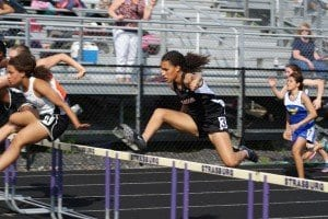 Mason track athlete Lauren Bowling is pictured above competing in the 100m hurdles event at the Bull Run District meet last Wednesday. She finished fourth with a time of 0:17.61.  (Photo: Carol Sly)