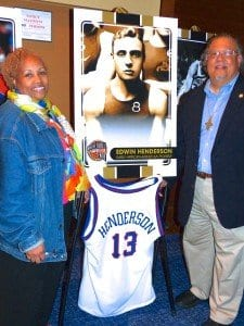 "Known as the ""Grand- father of Black Basketball,"" Dr. E.B. Henderson has been named to the Naismith Memorial Basketball Hall of Fame. He is pictured at right on a poster, flanked by grandson Edwin Henderson (right) and Nikki Graves Henderson, Edwin's wife, who led the effort to have E.B. Henderson inducted.  (Courtesy Photo)"