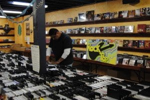 a customer looks through one of the CD bins at CD Cellar. The store usually has about 8,000 CDs in stock.